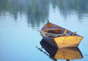Rowboat on a calm, peaceful lake